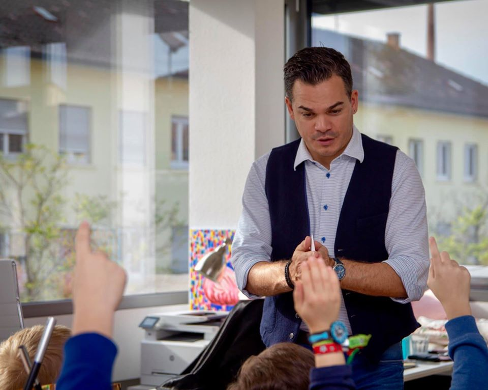 Marco Miele engages children in his magic show in Stuttgart